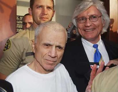 Actor and murder defendant Robert Blake (L), shown with one of those freaky, long-haired LA attorney types, is released from the Los Angeles central jail, March 14, pending trial for the shooting death of his wife.  Blake, who posted a $1.5 million bond, is charged with murder and other crimes stemming from the May 4, 2001 attack on Bonnie Lee Bakley, who was mortally wounded as she sat in her husband's car near a restaurant where the couple had just dined.  It is unclear at this point if Blake plans on remarrying and killing again before his trial begins. (Associated Press)