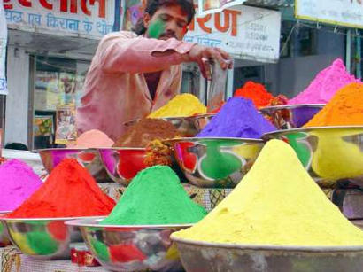 In an effort to increase sales in a shaky world economy, crack dealers in the Indian city of Bhopal have turned to marketing various brighter and more festive colors of the drug. The entrepreneur shown here is seen brazenly peddling the drug in broad daylight in the market square.