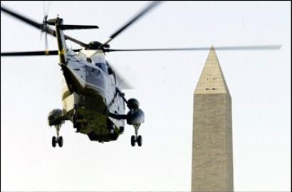 A super giant helicopter, capable of airlifting up to 15,000 people at once, is shown just as it clips off the top portion of the Washington Monument in our nation's capital.  The aircraft was recently commissioned as the largest object ever to fly in the history of mankind and was on hand for a demonstration yesterday when the mishap occurred.  Each blade on the top rotor is over four city blocks long.  (Associated Press)