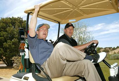 President George W. Bush, seen golfing here with friend Roland Betts, began hurling expletives at reporters shortly after slicing his driver into the woods for the second time.