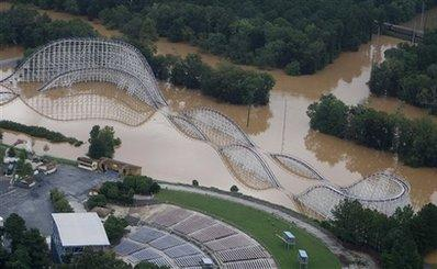 A new roller coaster at Six Flags of Georgia Amusement Park in Austell, Georgia, is shown above during one of the busiest days of the season. SwampThing features a top speed of 82 miles per hour, four drops of over 120 feet, and splashes through silt-laden swamp water near top speeds.  Many riders report being pummeled by debris and wildlife in the water, but argue that 'it's part of the experience.'  (Associated Press)