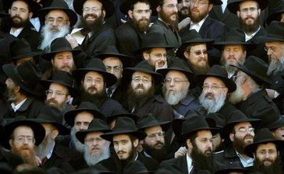 Rabbis of an ultra-orthodox movement assemble outside The Gold Club in Las Vegas for a first ever 'Rabbis of An Ultra-orthodox Movement Night' at the top-drawing strip club in Sin City. 'It's our annual trip to Vegas with a new angle on terrible impurity,' a spokesman said.  (Associated Press)