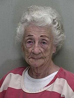 REUTERS - The booking mugshot of 92-year-old Helen Staudinger is seen in this handout released March 23, 2011. The central Florida woman fired a semi-automatic pistol four times at her 53-year-old neighbor's house after he refused to kiss her, police said on Tuesday. When she was questioned, she replied that, 'I even offered to put my teeth in but he said, 'Not even if you scrubbed off your eyebrows,' well, I just seen red.'