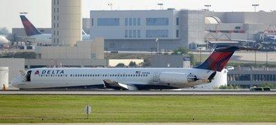 A Delta Air Lines jet sits at Atlanta's Hartsfield Jackson International Airport on Saturday, May 28, 2011. The flight crew became inebriated during the three-hour flight and failed to deploy the landing gear, but the flight's approximately 50 passengers and crew were evacuated safely, authorities said.  (Associated Press)