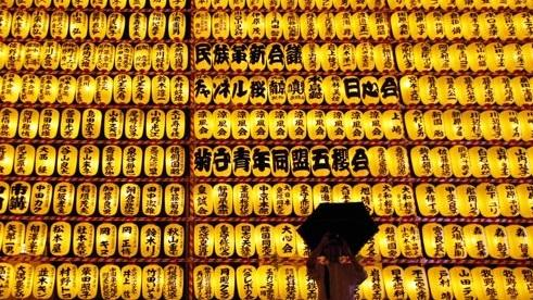 A visitor takes a picture while holding an umbrella in front of paper lanterns during the annual Mitama festival at the Yasukuni Shrine in Tokyo. About 3,000 paper lanterns are lit to comfort the souls of dead during the annual festival at the shrine where more than 2.4 million war dead are enshrined. 'We don't have a lot to do now that most of the manufacturing has moved to China,' stated Issei Kato. (REUTERS)