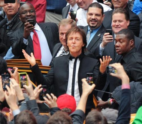 Paul McCartney arrives with his band to give a surprise pop up concert in Times Square on Thursday, October 15. The band played 'Band On The Run' nine times in a row much to the delight of onlookers. 'I couldn't believe it when they played it the fourth time, and then, like, five more?!', stated Jasmine Alborn, who left work early to enjoy the freebie. McCartney will release his new album called 'New' on October 15. (Associated Press)